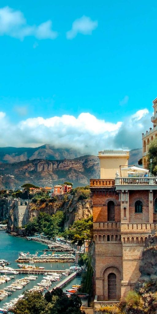 Sorrento is a town overlooking the Bay of Naples and a popular tourist destination due to its variety of small antique shops.
