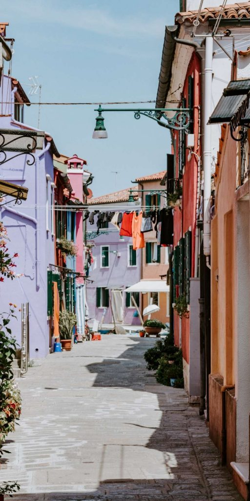 To visit Burano and see the colorful fishermen's cottages and pretty canals, you can take a 40-minute water bus (Vaporetto) ride from Venice.